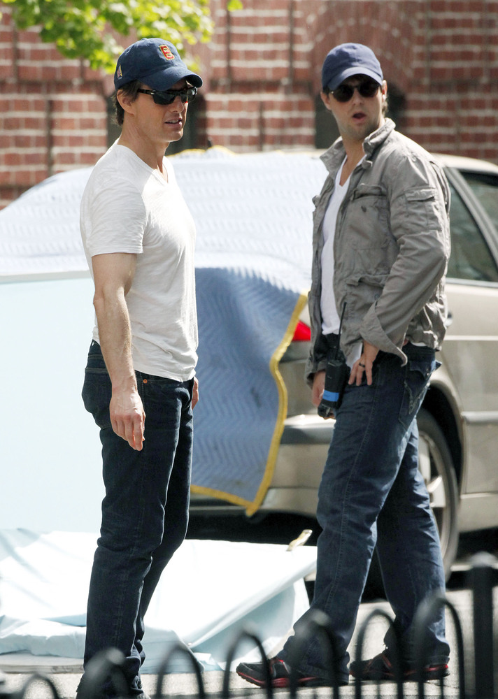 3) Tom Cruise (left) with his stunt double on the set of Knight and Day.