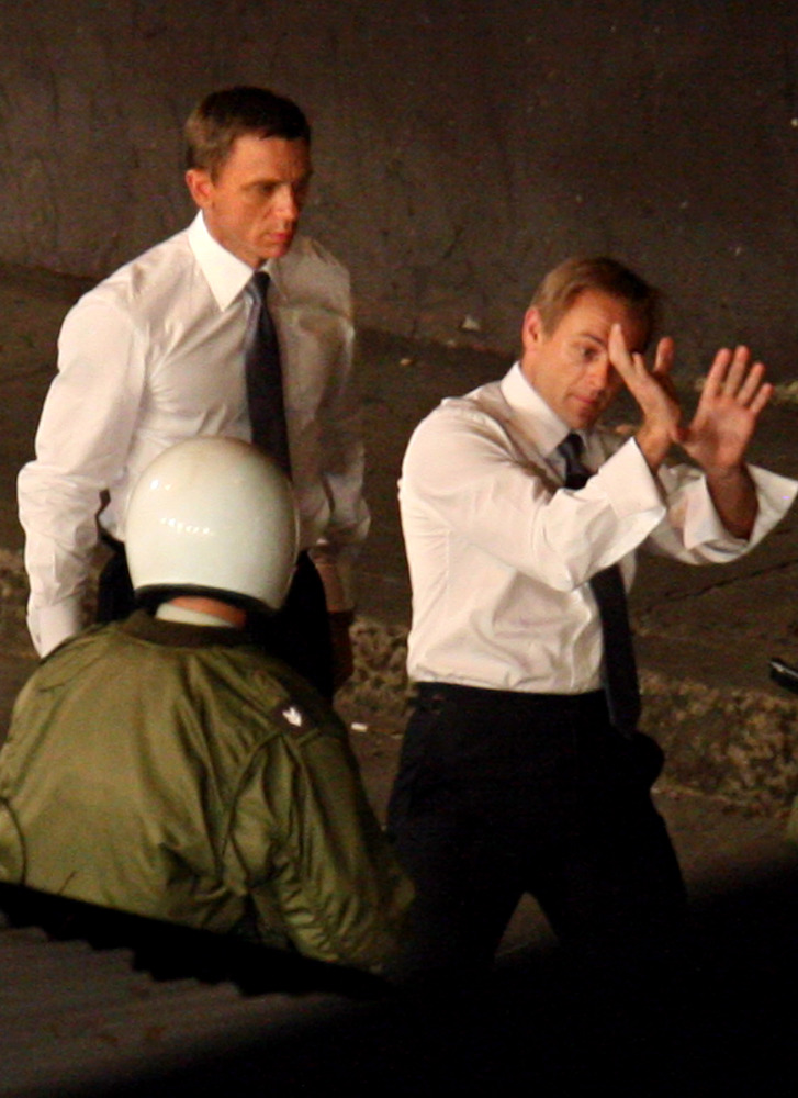 9) Daniel Craig (left) playing James Bond watches intently as his stunt double went through a fight scene on location in Panama City, Panama during filming of Quantum of Solace.