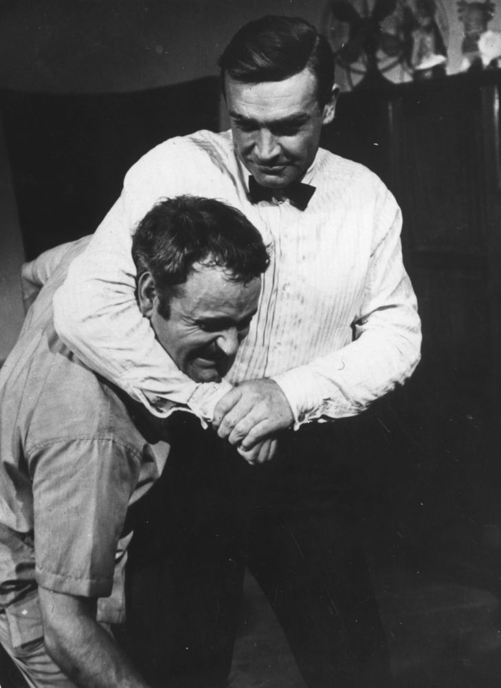 13) James Bond actor Sean Connery (right) holding his stunt double, Alf Joint, in a headlock during the filming of Goldfinger.