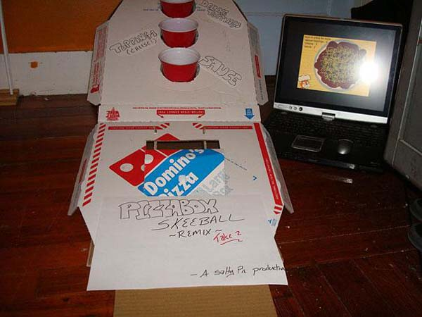 10.) Mini pizza box skeeball.
